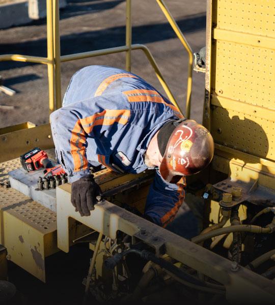 Bulk Team Member Repairing Equipment