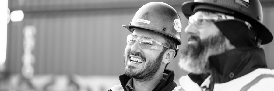 Two Bulk Team Members Smiling & Wearing Hard Hats, Safety Glasses