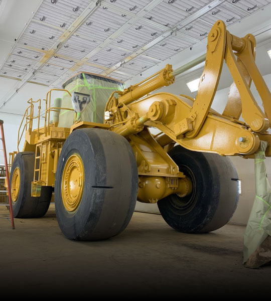 Yellow Heavy Equipment In The Process of Being Rebuilt by Bulk's Team