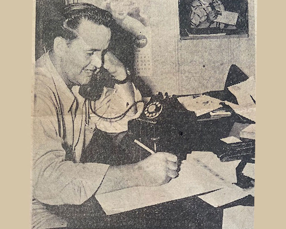 Leonard Brown Back In The Day Talking On The Dial Phone And Taking Notes On A Notepad