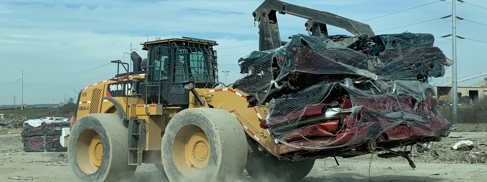 Cat® Bulldozer Hauling Car Scraps At Scrap Recyling Center