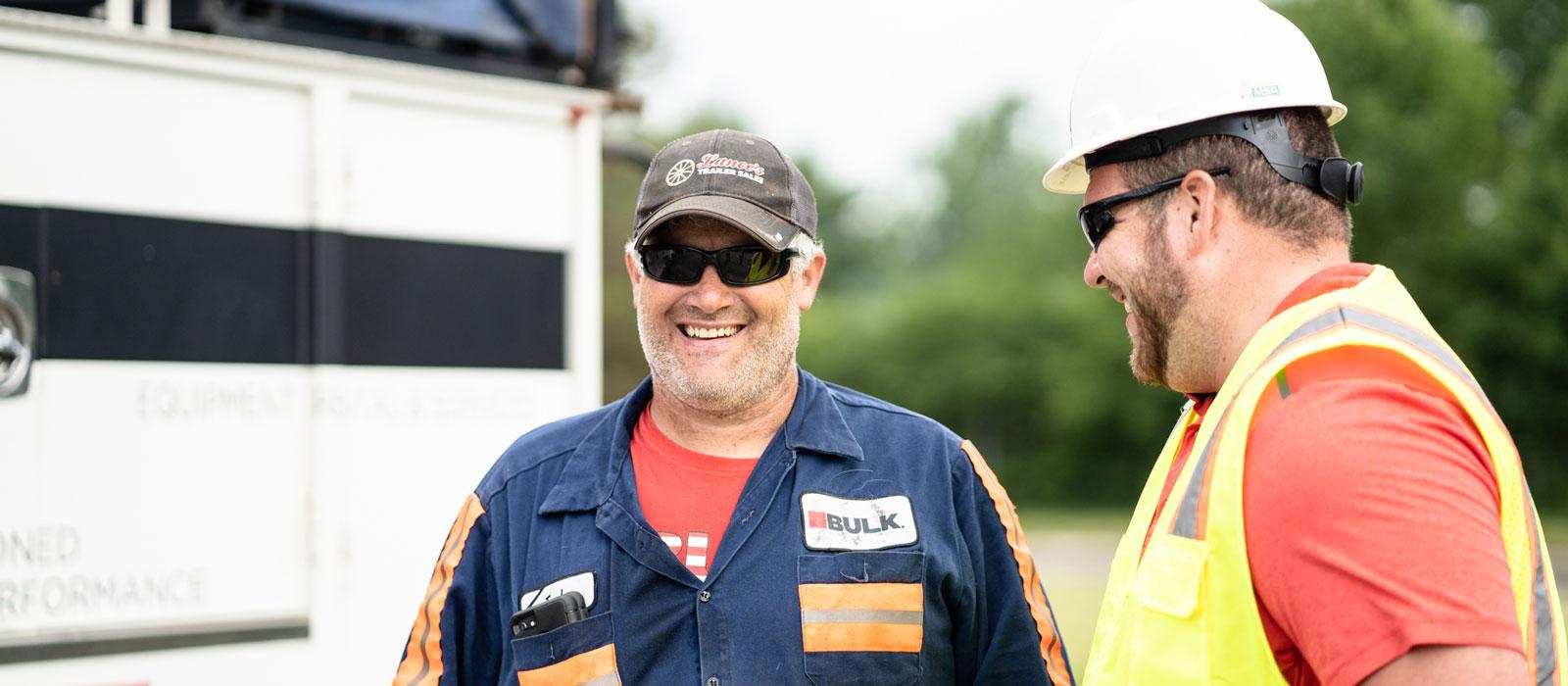 Two Bulk Employees Smiling