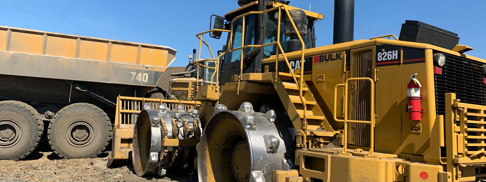 Cat® 826h And Dump Truck At Project Site