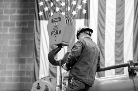 Bulk Employee At Work With Us Flag In The Background